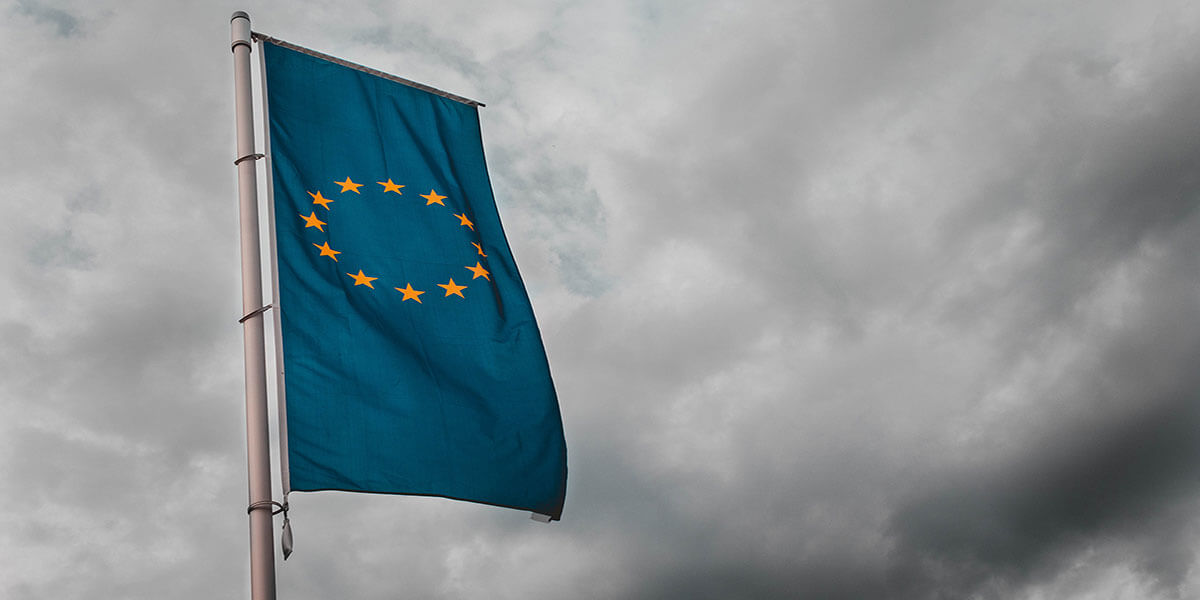European Union flag waiving on a blue background