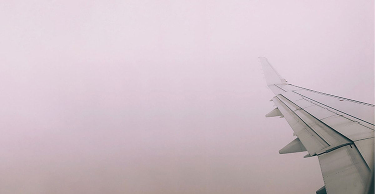 An airplane wing in thick fog.