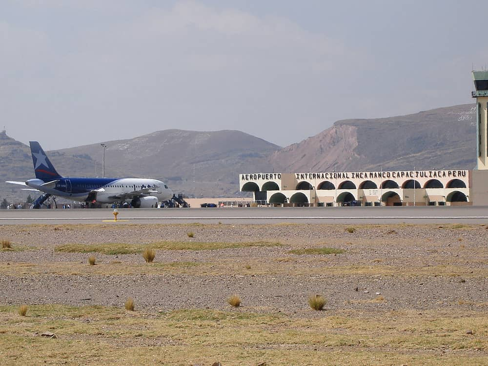 A taxiing airplane on Aeropuerto Internacional Inca Manco Capac in Peru.