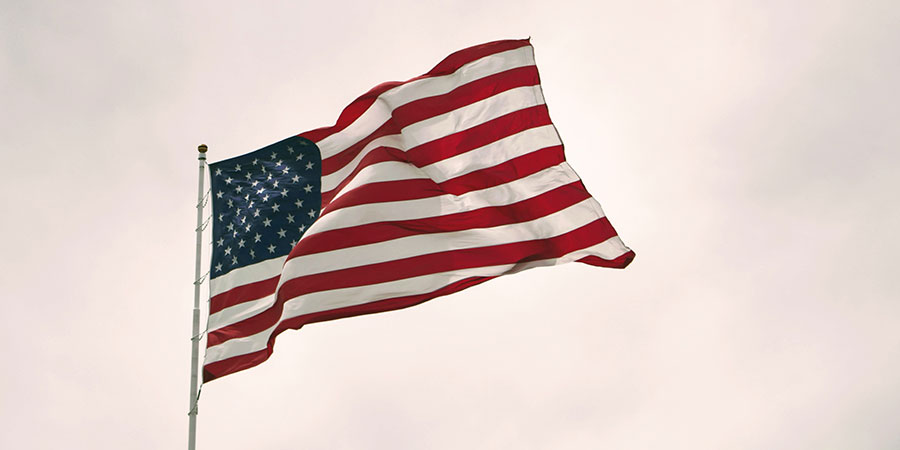 USA flag waiving on a gray background