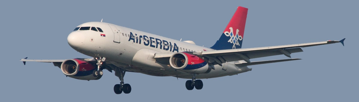A white, blue and red Air Serbia aircraft during flight.