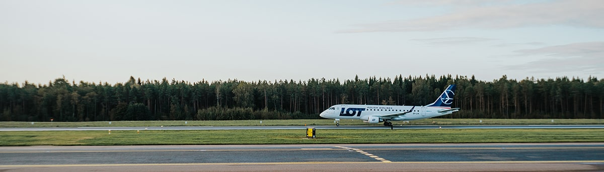 A white LOT Polish Airlines' aircraft ready for takeoff.