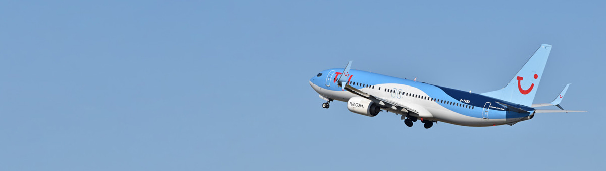 A TUI aircraft in-flight on a blue background.