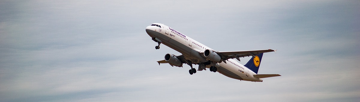 A white Lufthansa aircraft shortly after takeoff.